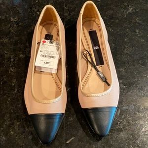 Tan and black pointed toe flats